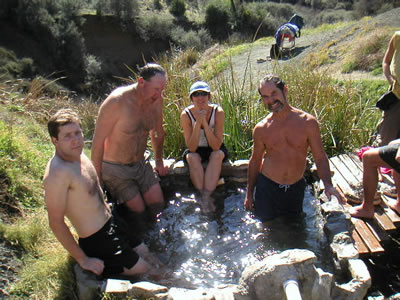 People soaking in Little Caliente Hot Spring